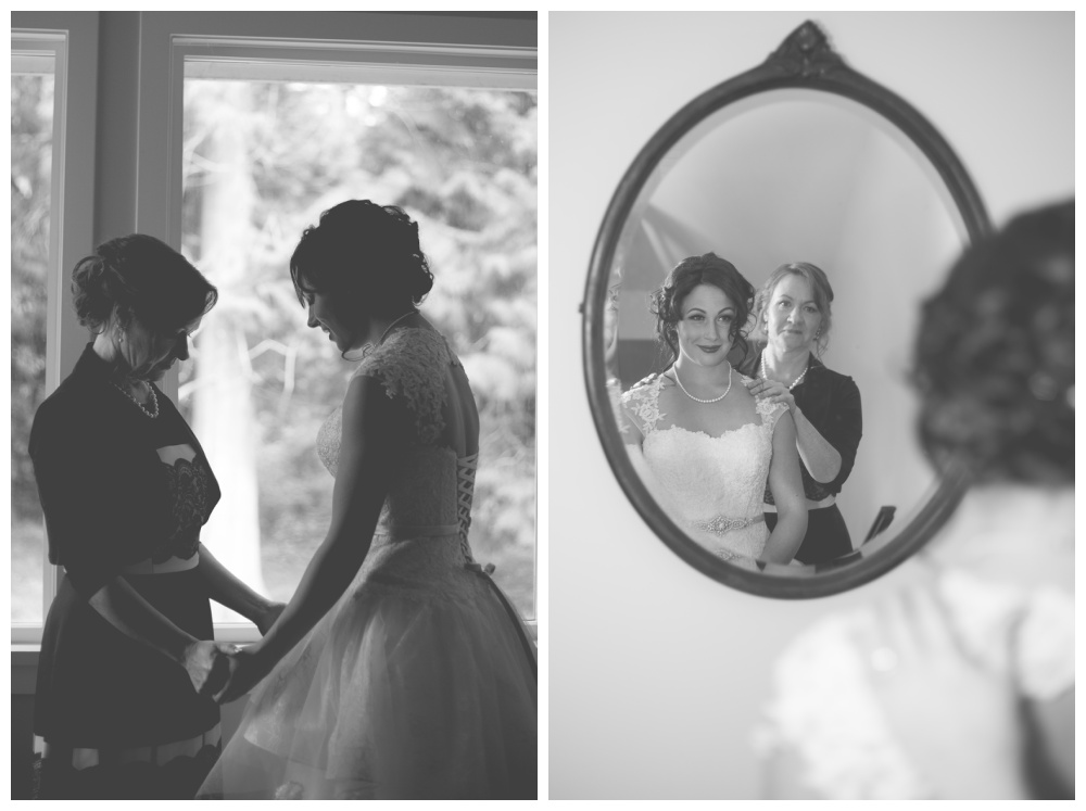 Black and white image of a bride sharing a special moment with her mom before the wedding