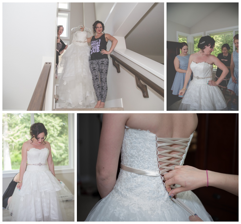 Bride gets help putting on her gown from her bridesmaids