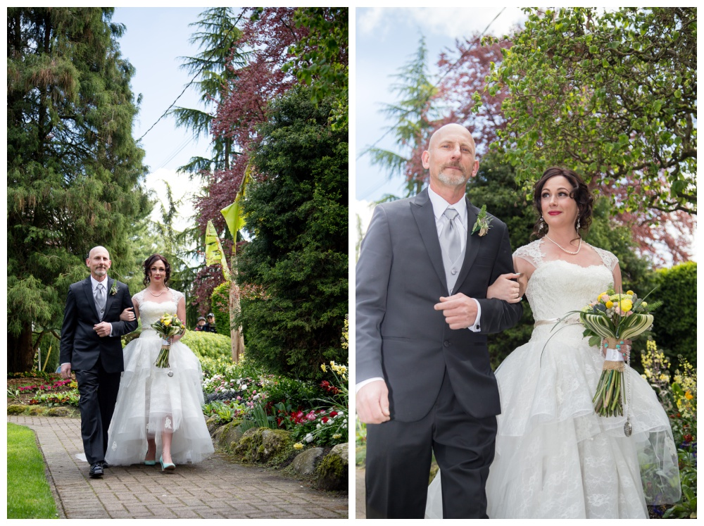 Bride and her father walk down the aisle.