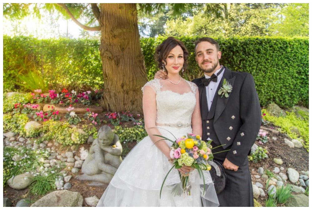 Bride and groom in the Rose garden at Queens Park