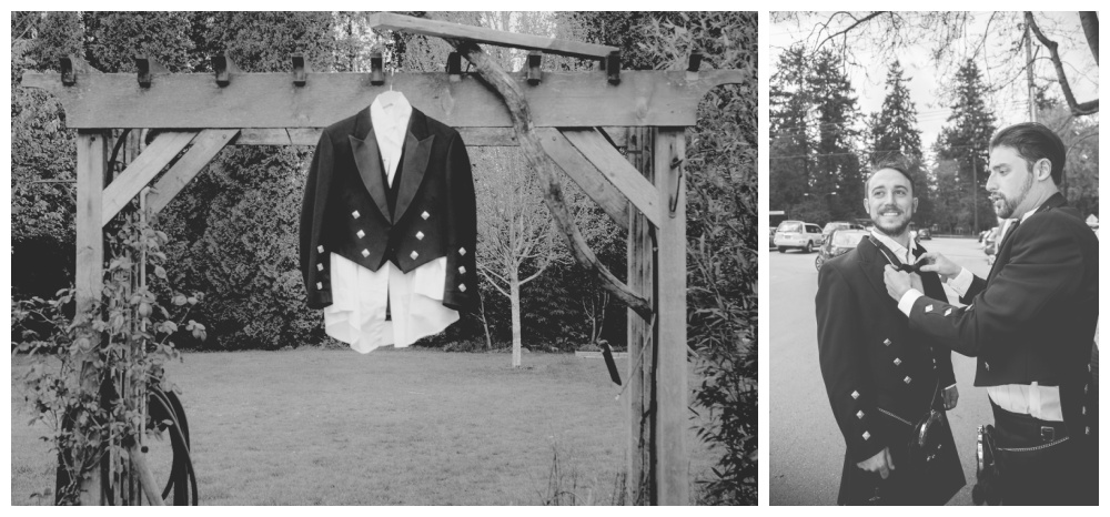 The grooms suit hangs outside on an arbour.