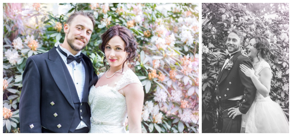 Bride and groom with a flowery backdrop at their Queens Park wedding